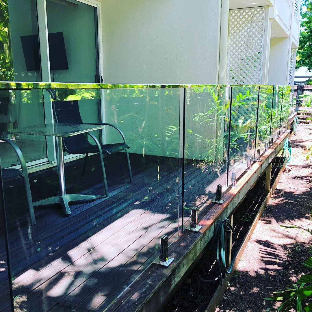 Deck mounted, frameless glass balustrade, stainless handrail, Port Douglas