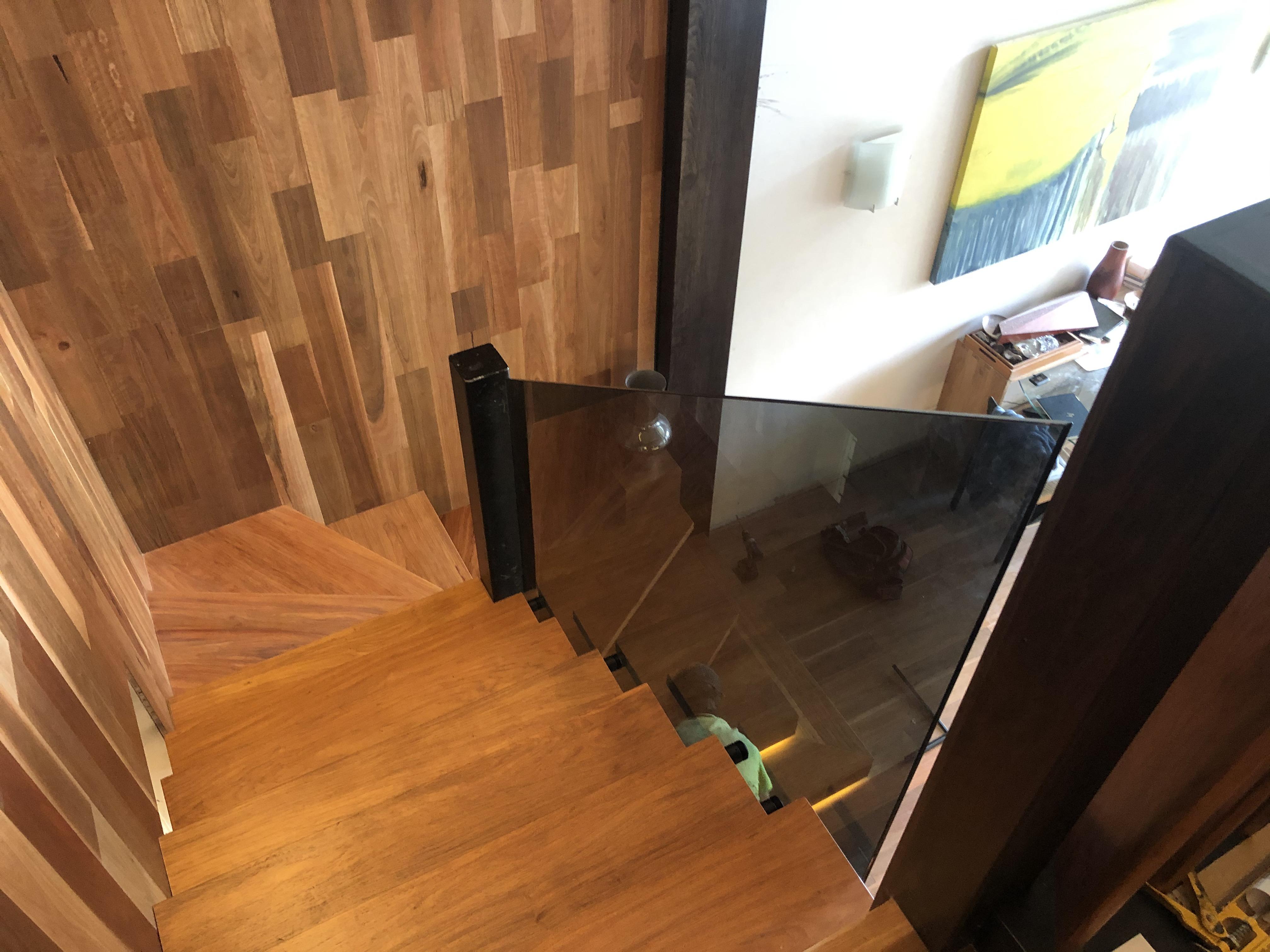 Grey, tinted glass, stairway balustrade, matte black hardware, port douglas