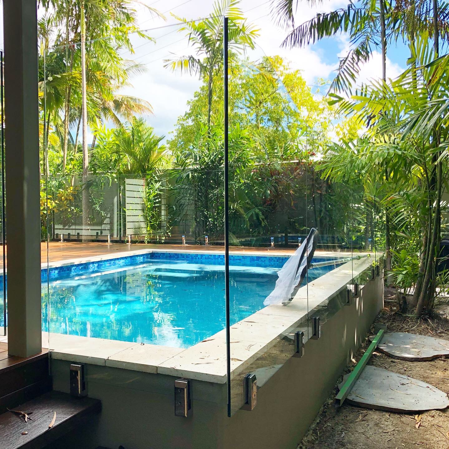 Wall mounted stainless spigots, fully frameless glass pool fencing, Cairns
