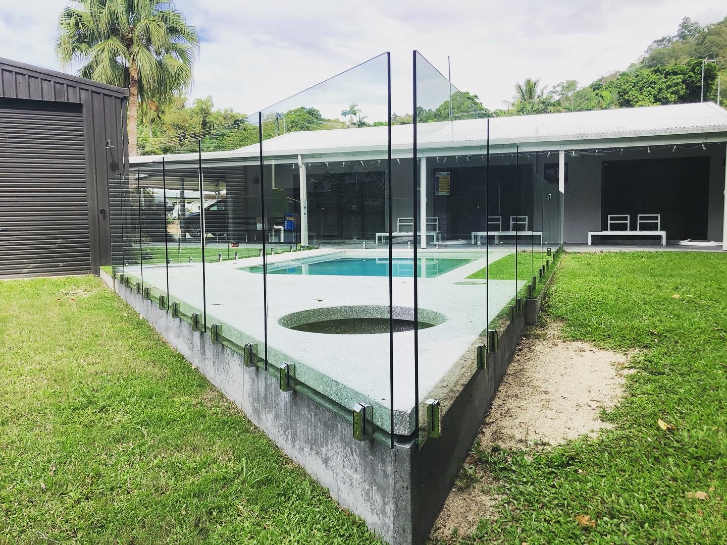Frameless Glass Pool Fencing, wall mounted stainless spigots, Cairns